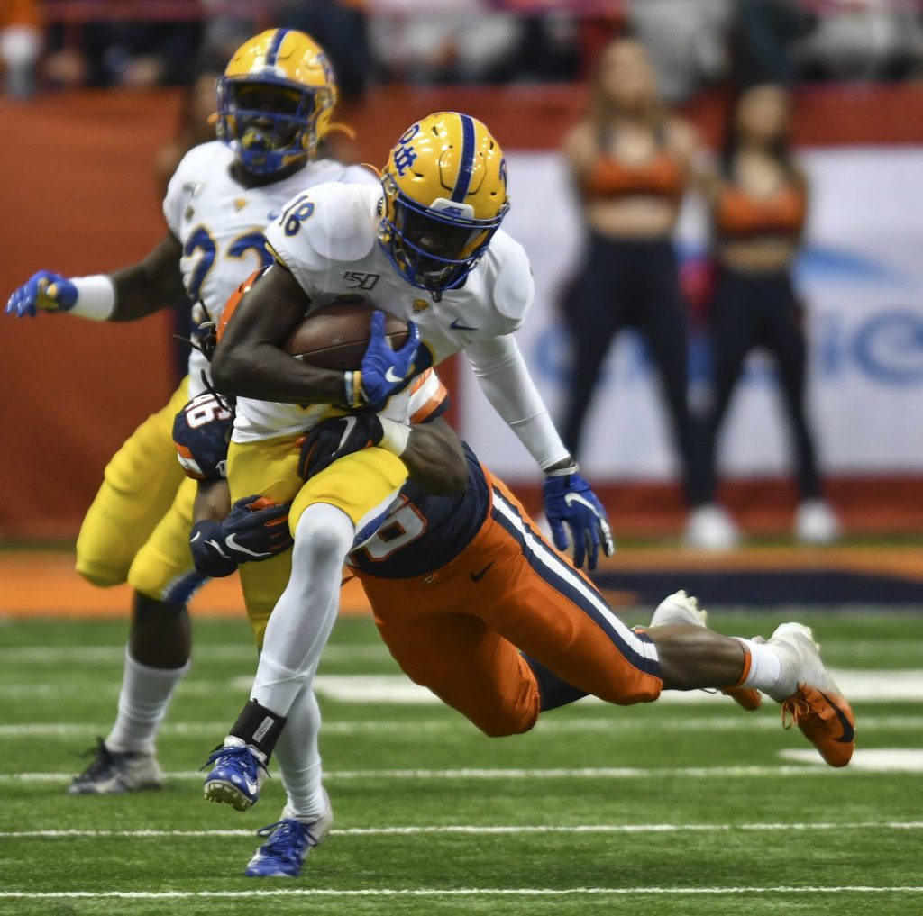 Pitt receiver, Shocky Jacques-Louis, is brought down by Syracuse Linebacker Lakiem Williams.