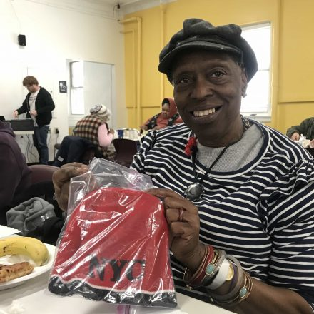 Carolyn E. Wallace during lunch at the Westcott Community Center, holding her bingo prize.