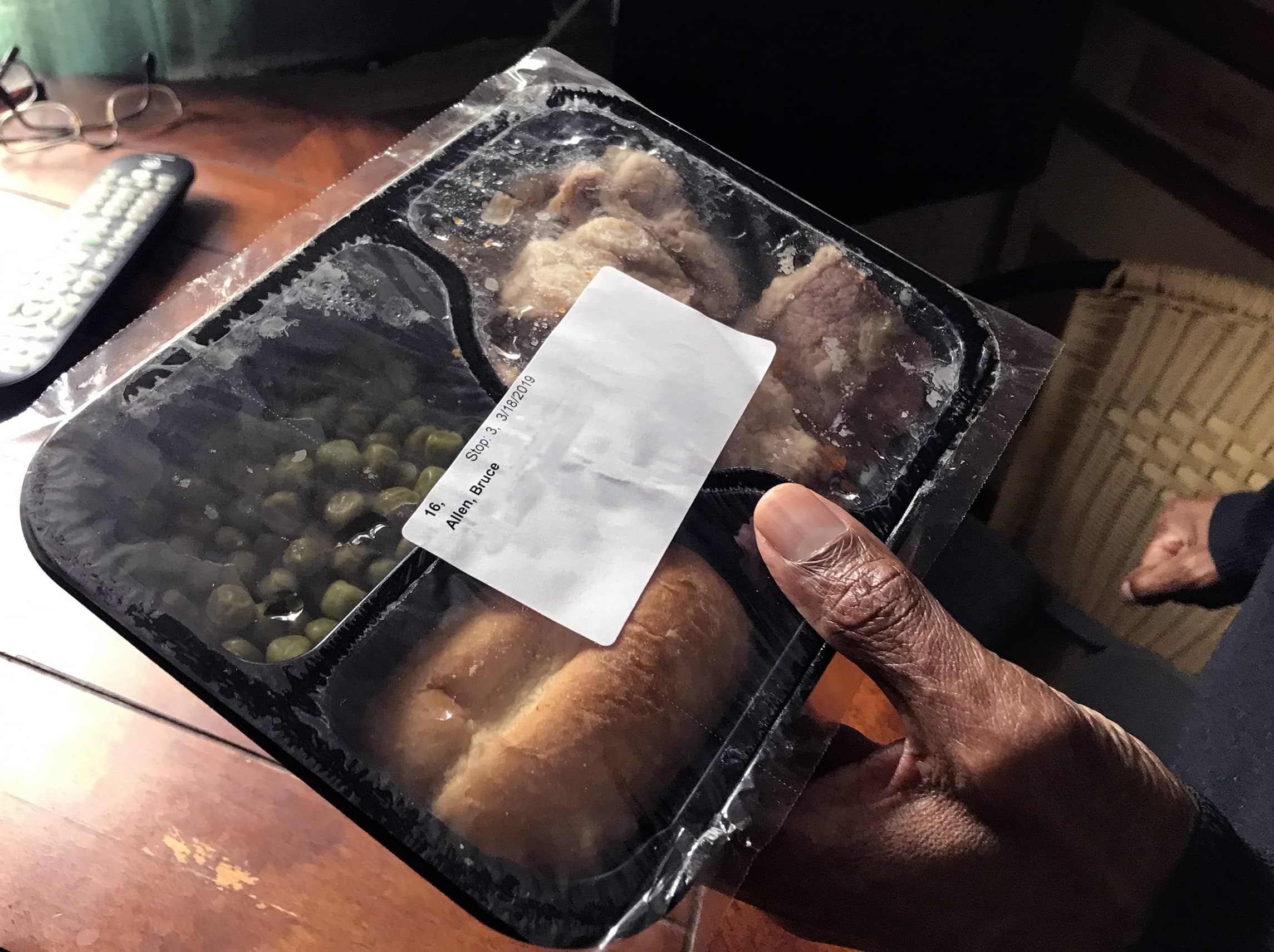 Bruce Allen holds one of his meals from Meals on Wheels. Sometimes, he'll mix the meal with ingredients he has in his cabinets to create a new dish.