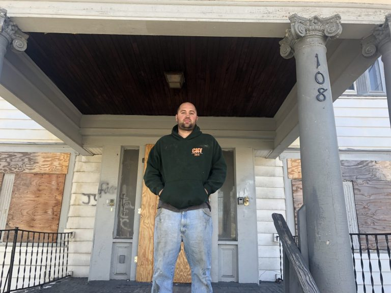 Paul Finch stands on the porch of the house at 108 Onondaga Avenue that he is restoring in spring 2019.