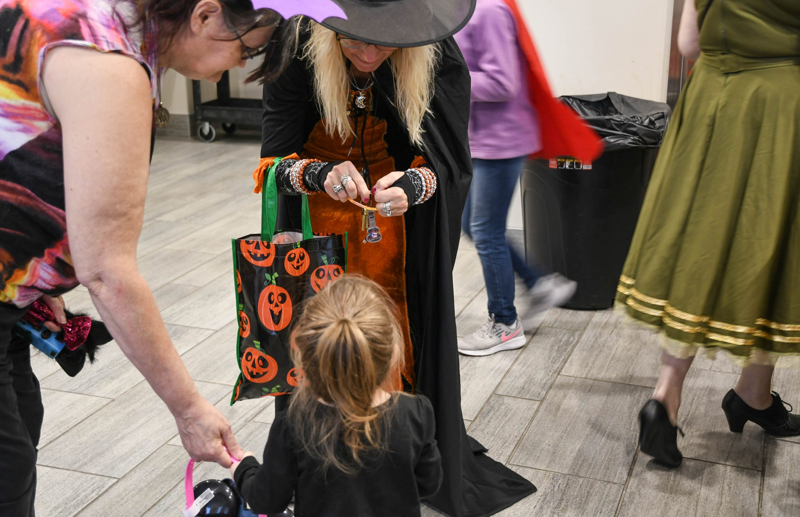 Clinton Plaza Manager Dana Natale gives candy to Sky Warwick, 2.