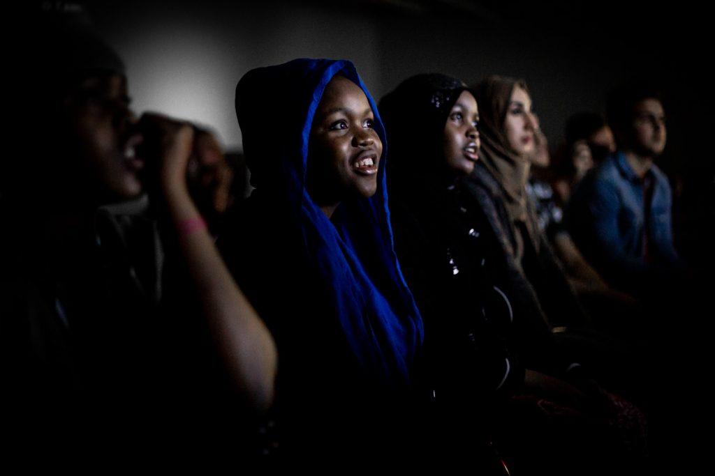 girls watching a film