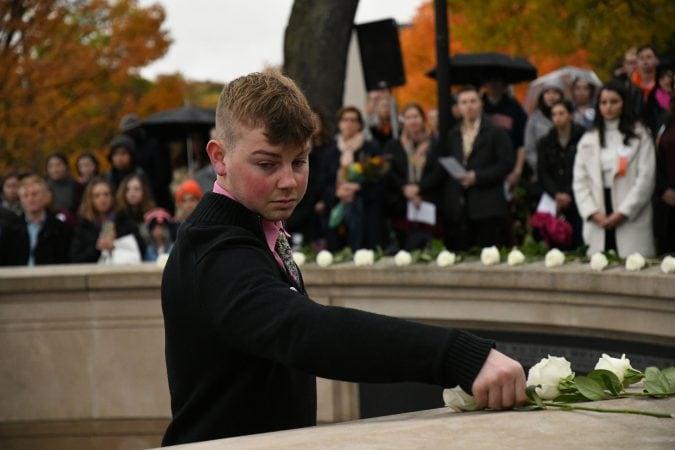 Lockerbie scholar Brodi Chambers places a rose during Friday's tribute services Syracuse students lost in Pan Am Flight 103.