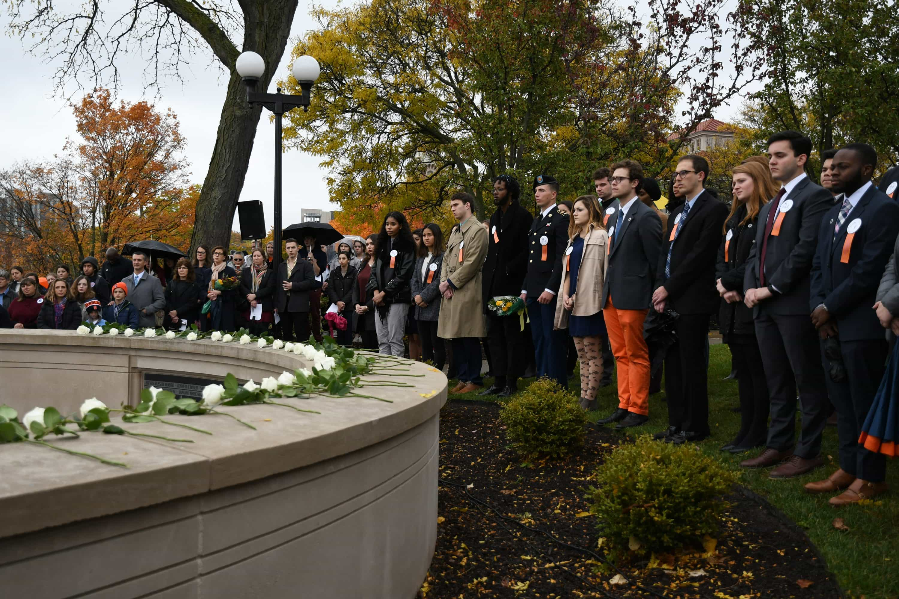 Remembrance Scholars honor the 35 SU students lost during a rose-laying ceremony on Friday.