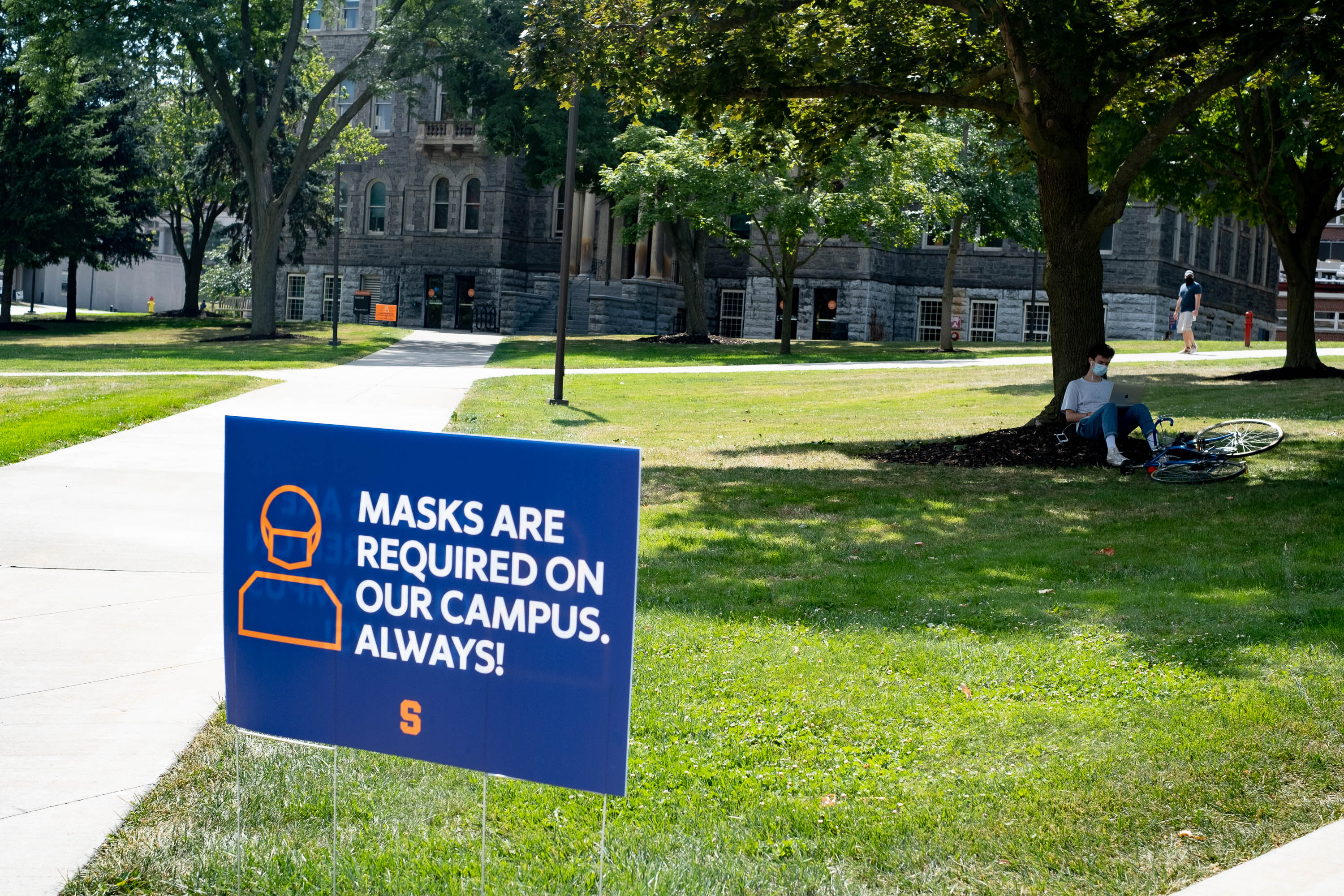 On August 24, 2020, the first day of classes at Syracuse University, a sign reminds students to wear their masks at all times.