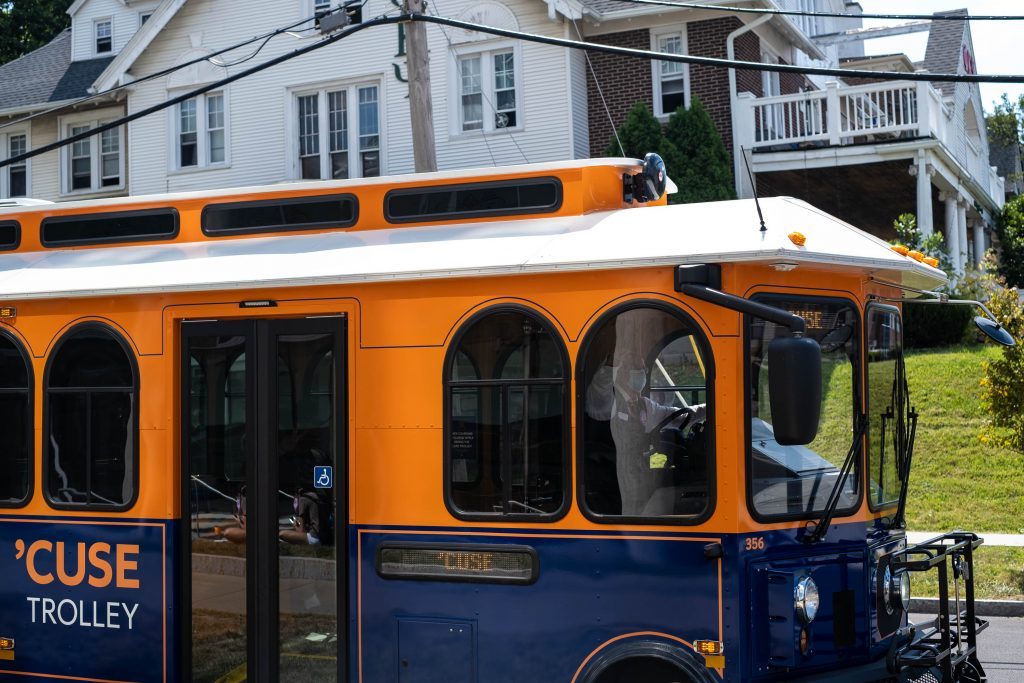 The 'Cuse Trolley Busdriver waves as he passes the intersection on August 24, 2020, the first day of classes.