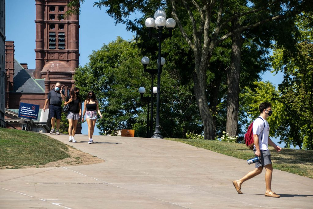 Students walk to class on the SU campus on the first day of school for the 2020-2021 school year.