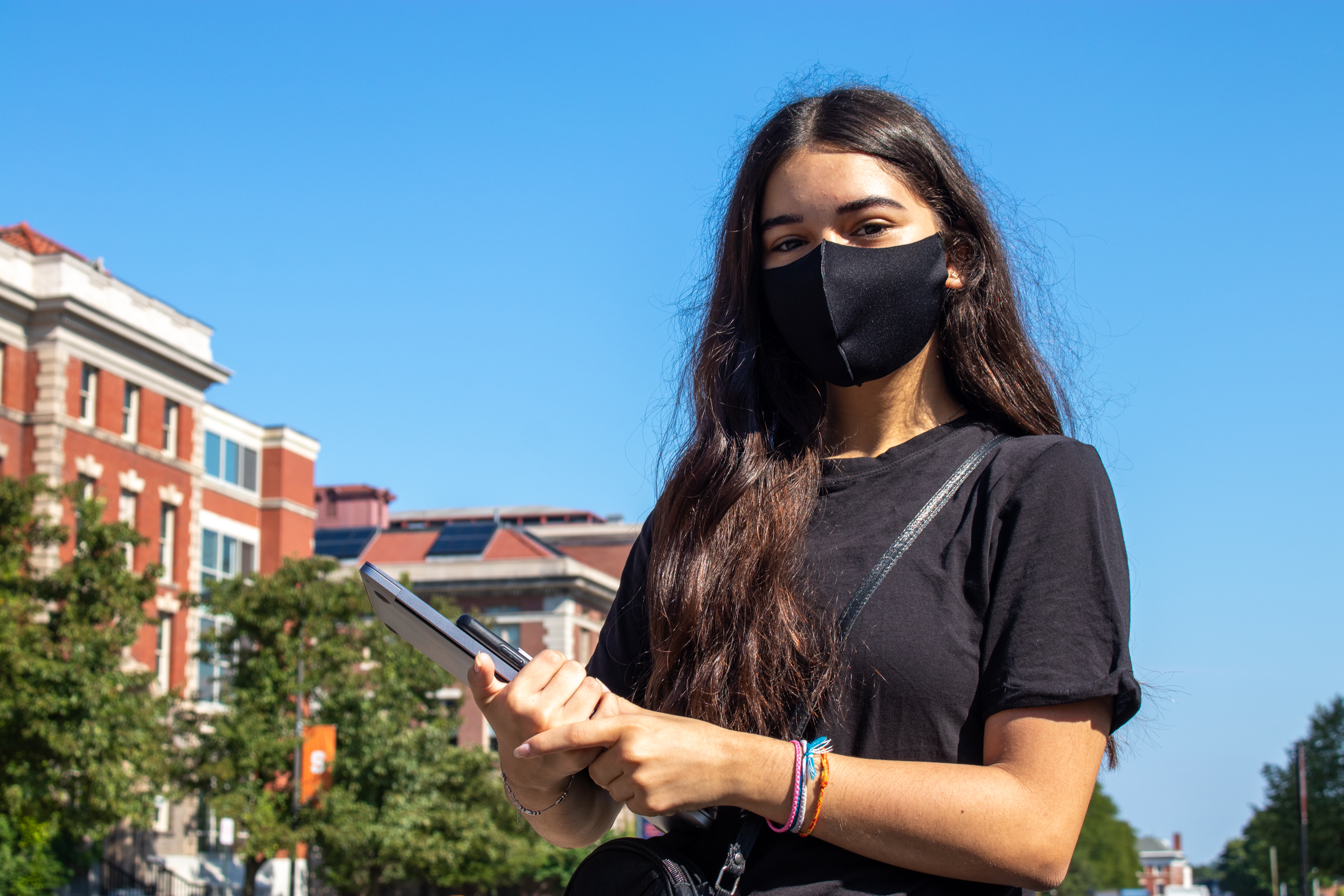 Management freshman Zain Nsour dons a black mask which completes her all-black outfit—though she said it wasn't planned. She woke up late for her first class and was scrambling to get out the door, and just grabbed the first mask she saw.