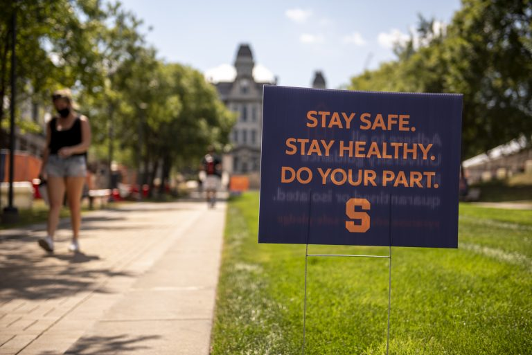 Sign touting the COVID-19 safety pledge on SU's campus on Monday, Aug. 24