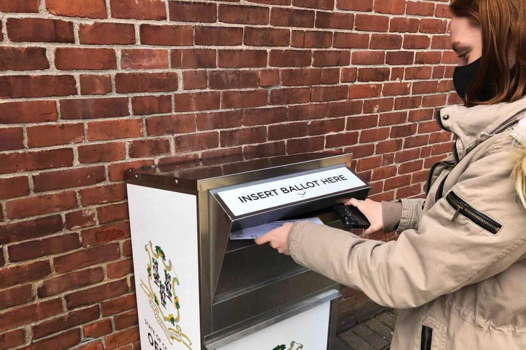 Anne Hayes submits her 2020 election ballot in Connecticut.