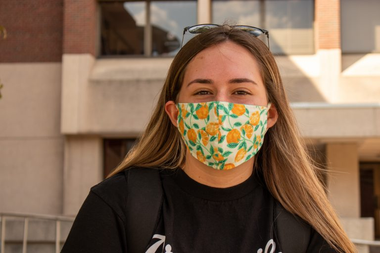 """Nutrition Science grad student Melissa Navarro shows some Orange pride by wearing a mask adorned with oranges. """"I bought the mask from my friend's Etsy shop and as soon as I saw the one with oranges and I couldn't resist."""""""