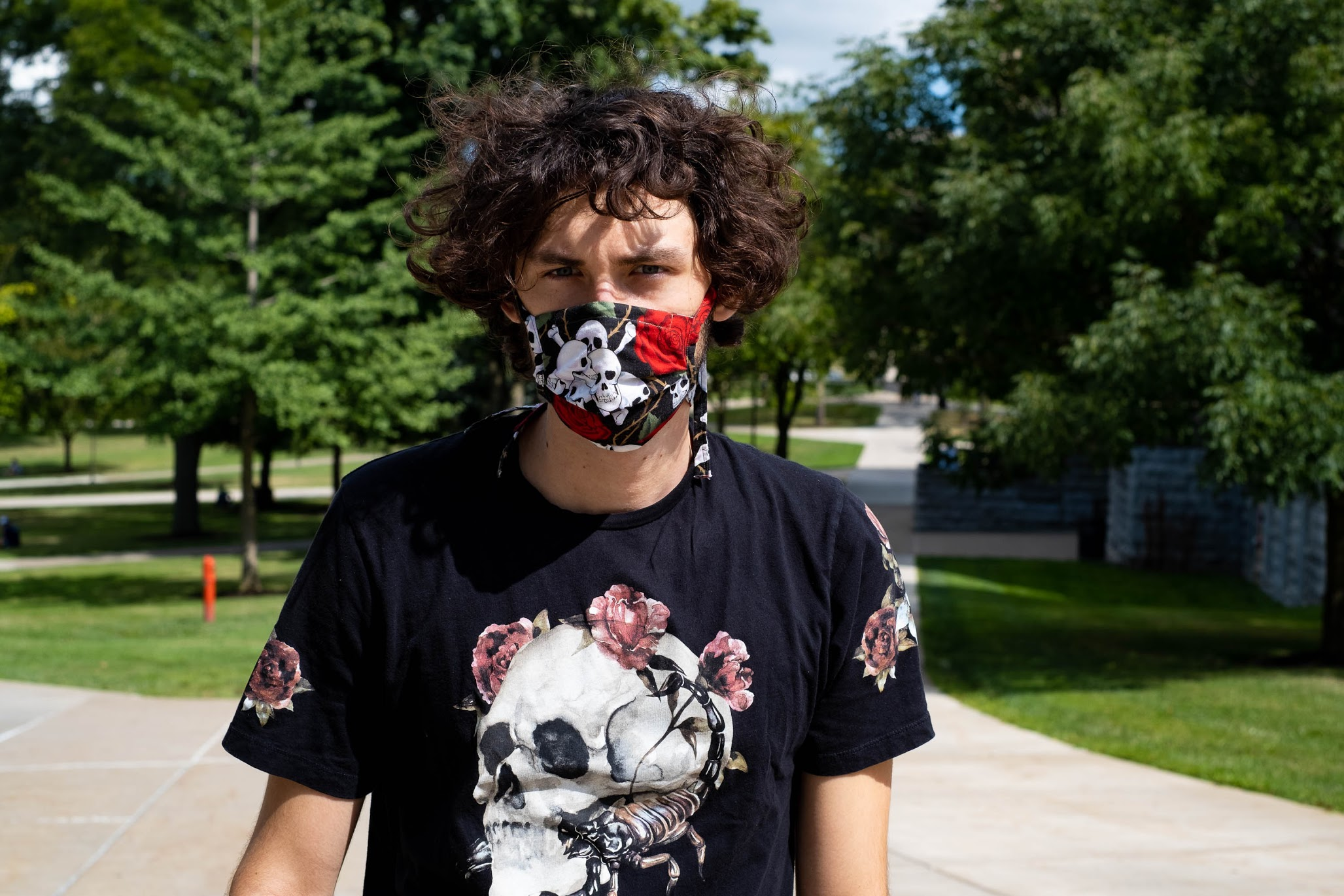 """For engineering & computer science sophomore Griffin Maffioli, wearing a mask is just another way to accessorize. """"It's just about finding something that matches what you already like to wear. It's just adding one more piece of cloth to your outfit."""" Photo by Kennedy Smith."""