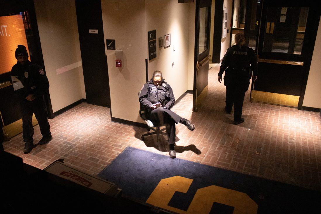 DPS officers guard one of the entrances to Crouse-Hinds Hall on the night of February 18, 2020.