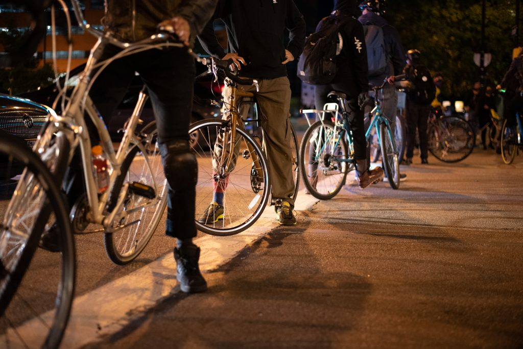 Protestors on bikes led the march, blocking off streets from traffic and creating a barrier between police cars and the crowd. Rochester, NY. September 11, 2020.