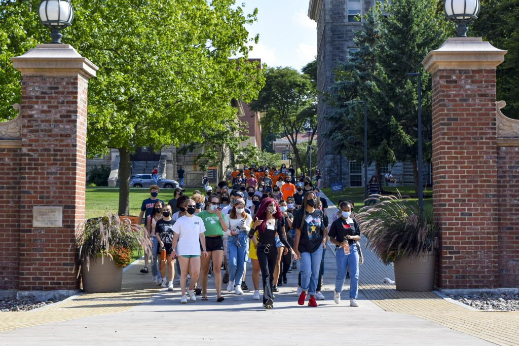 SU Student Association president Justine Hastings leads a group of students on a solidarity march through campus on Friday.