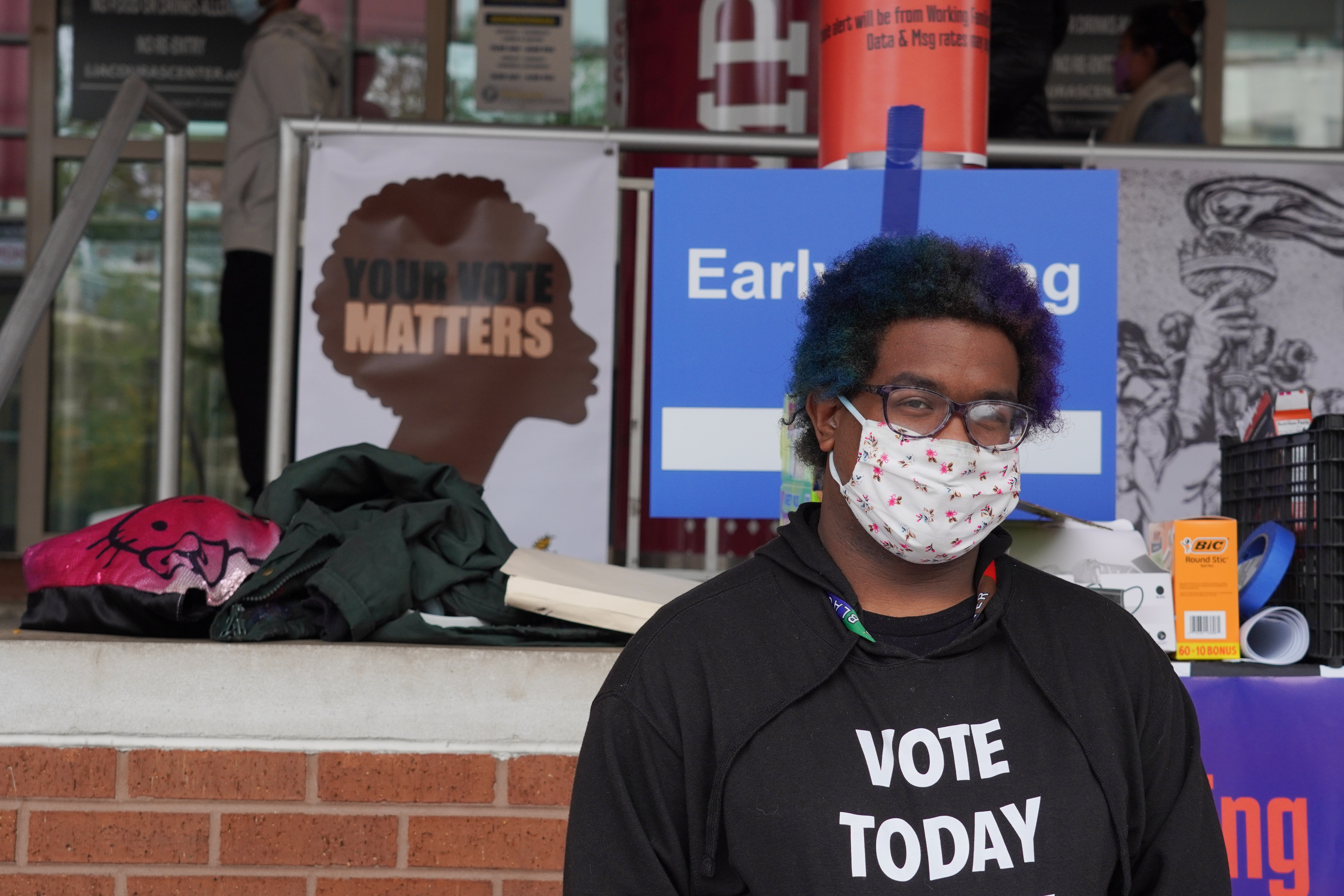 Mykayla, a volunteer for the Working Families Party tables at the entrance of Temple University's Liacouras Center in Philadelphia, Penn., on October 26, 2020.
