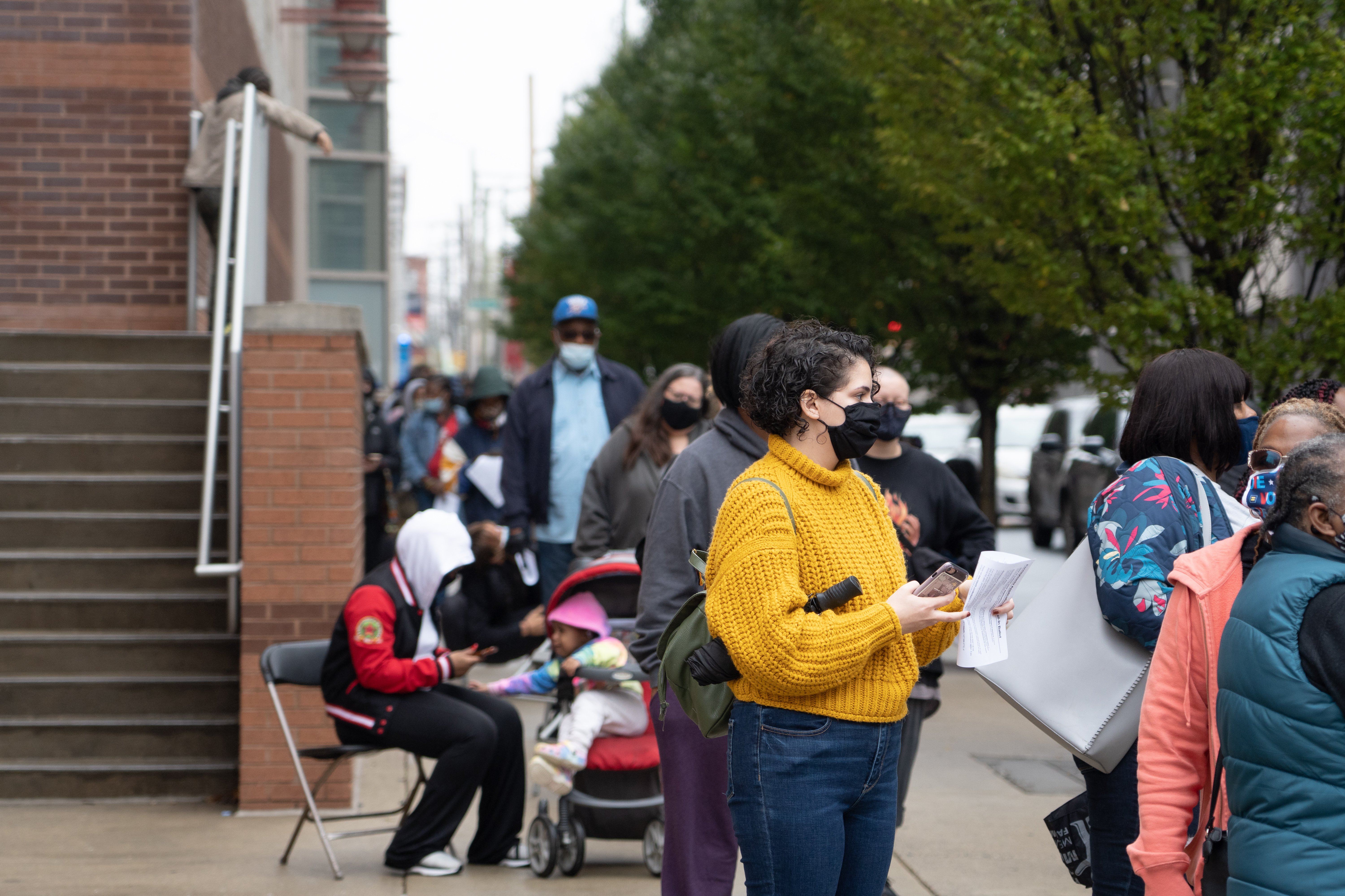Voters waited in line with their mail-in ballot applications outside of Temple University's Liacouras Center in Philadelphia, Penn., on October 26, 2020