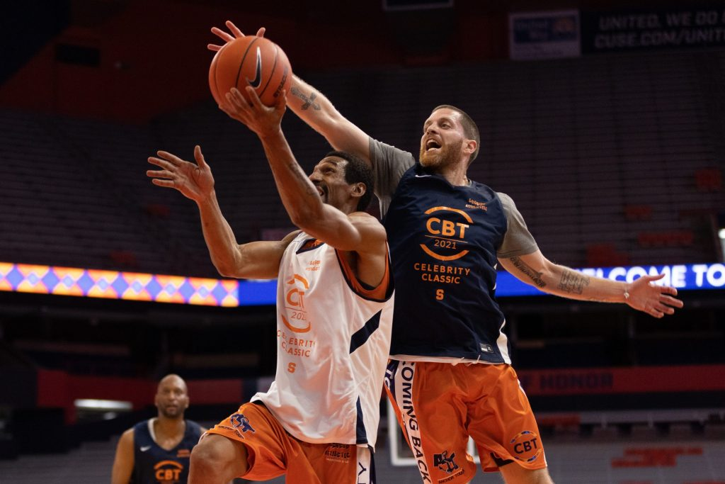 Eric Devendorf, right, comes soaring in from behind to block Lawrence Moten's layup attempt during the 2021 Coming Back Together (CBT) Celebrity Classic, Thursday, at the Carrier Dome.