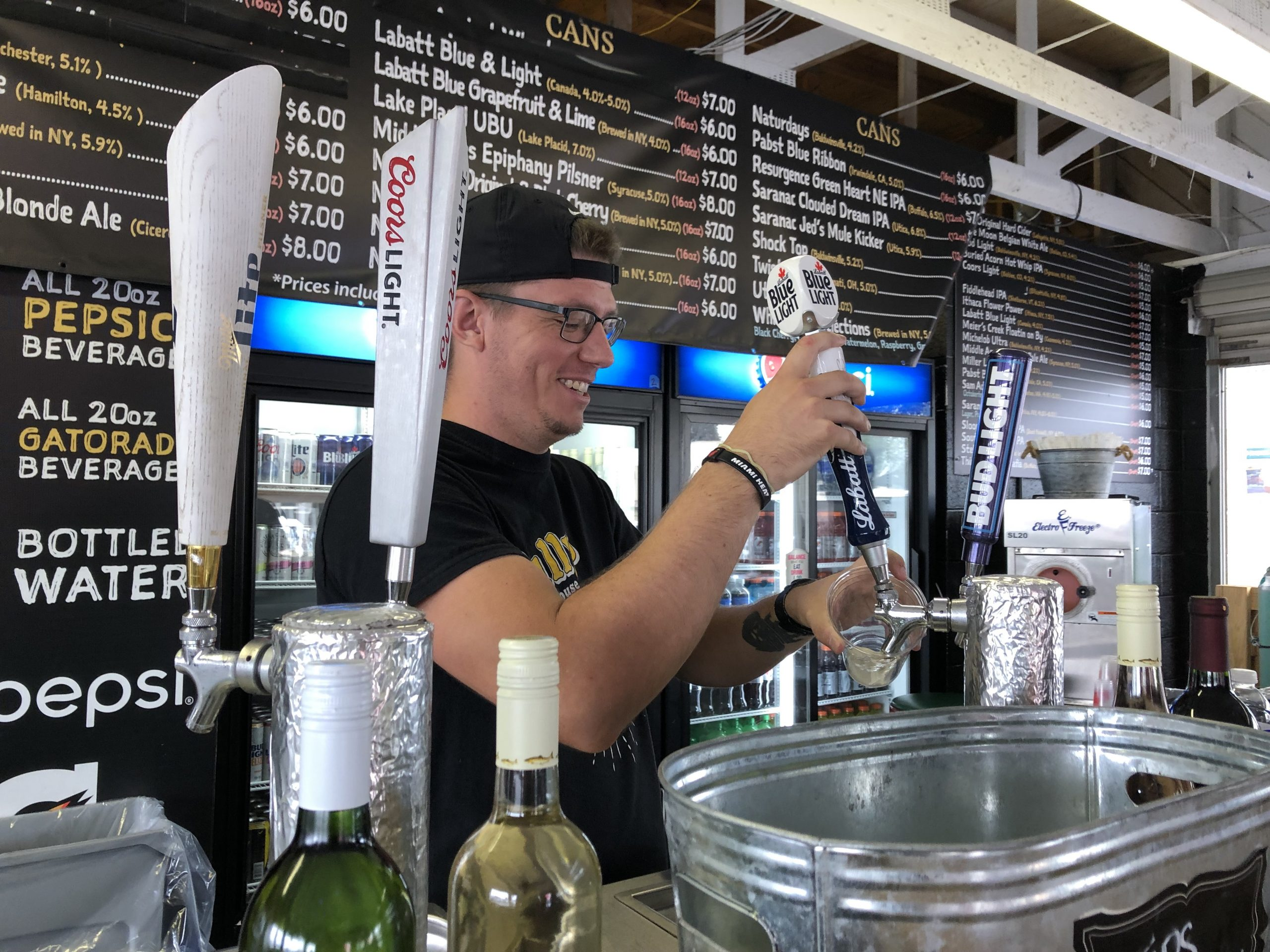 Tully's bartender Adam Gillis serves drinks to customers at the New York State Fairgrounds.