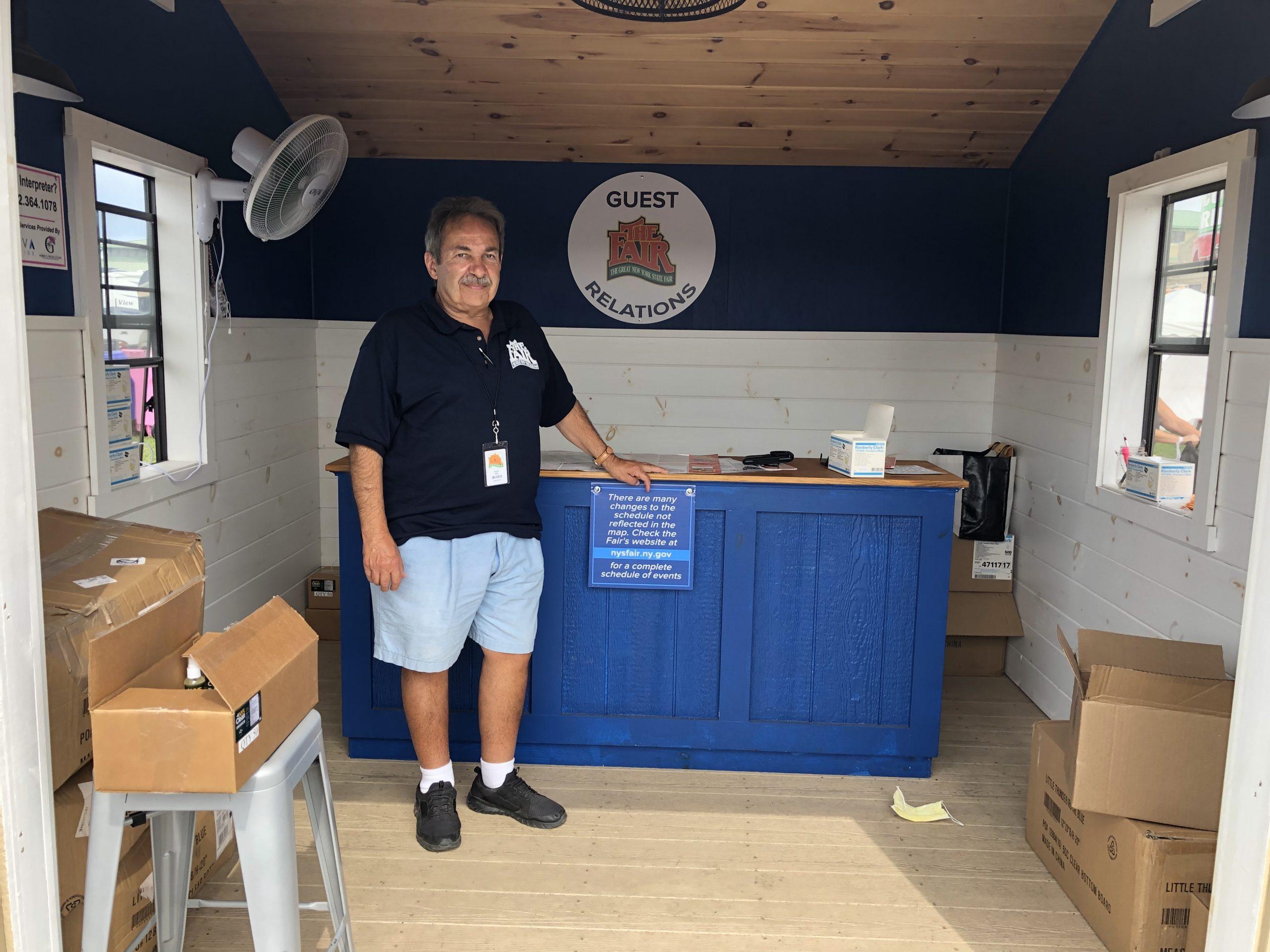 John. De Carlo, New York State Fair employee, poses near his work station.