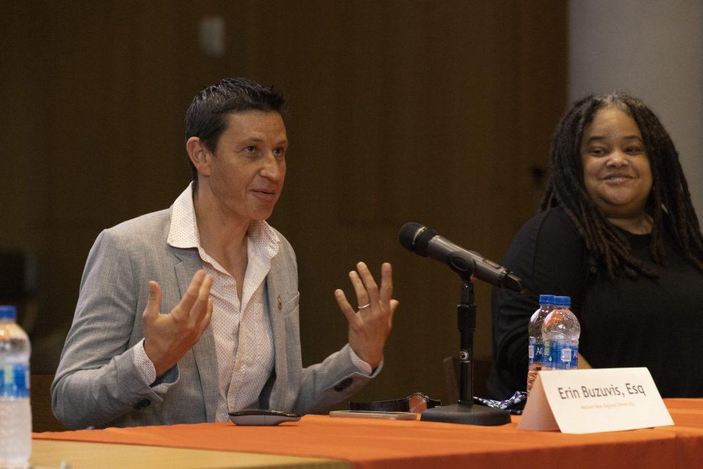 Erin Buzuvis (left) speaks during the Title IX panel as Dr.