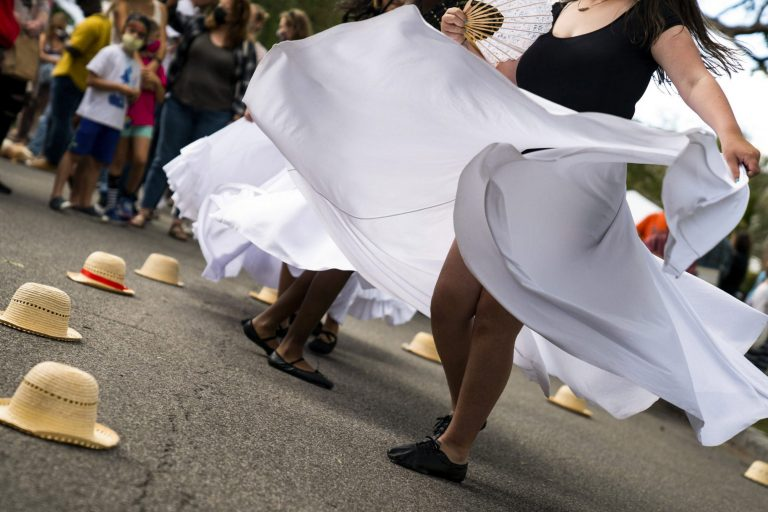 A local Latin dance group for girls performs on Victoria Place at the. Westcott Cultural Fair.
