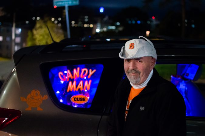 The Syracuse Candyman, Troy Boyer, stands on the corner of Comestock Avenue and Marshall Street near SU's campus.