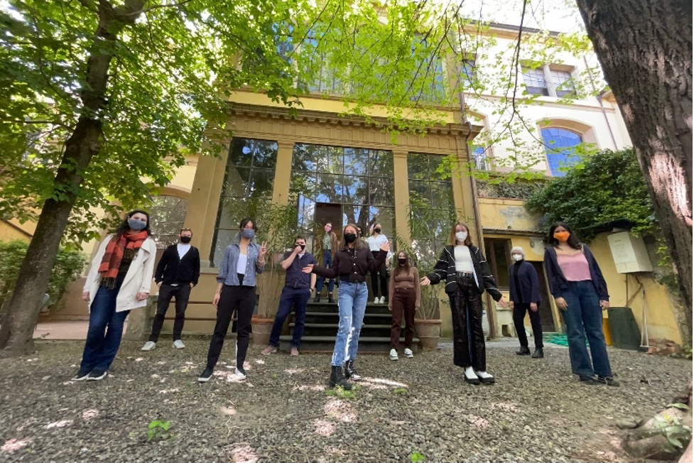 SU architecture students studying abroad in Florence, Italy, stand in the School of Architecture Garden.