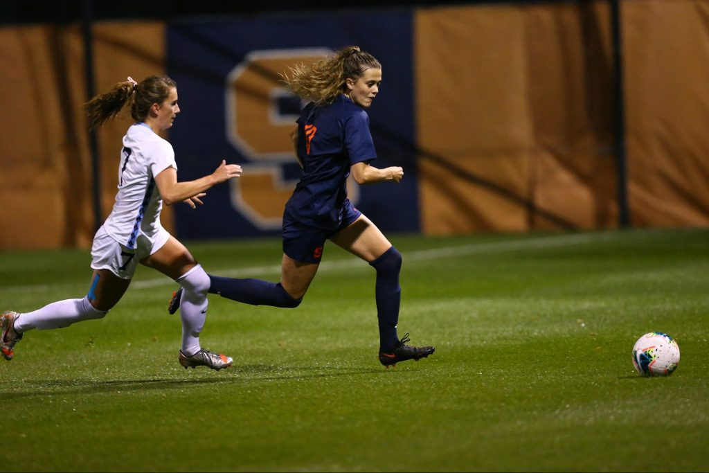 Hannah Pilley beats a UNC defender to the ball in Thursday night's home game against the Tar Heels.