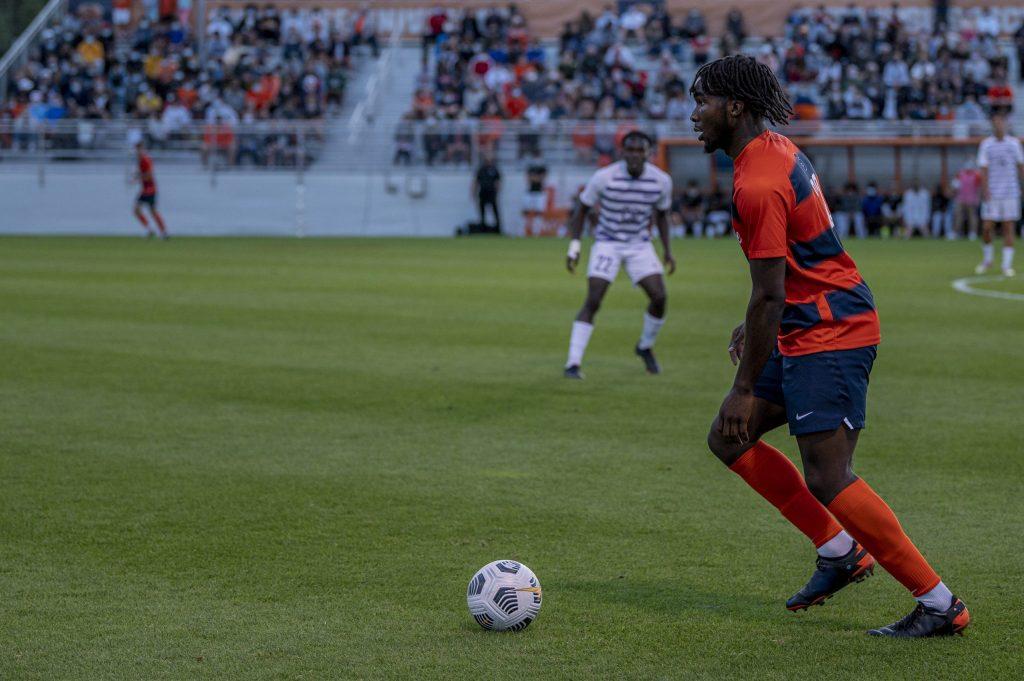 Freshman defender Olu Oyegunie controls a ball during a Syracuse men's soccer match against Niagra at the SU Soccer Stadium, September 6.