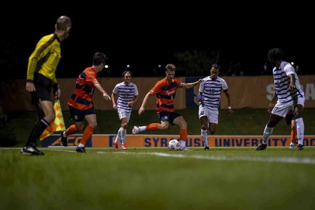 Junior defender Noah Singlemann passes a ball during a Syracuse men's soccer match against Niagra at the SU Soccer Stadium, September 6.