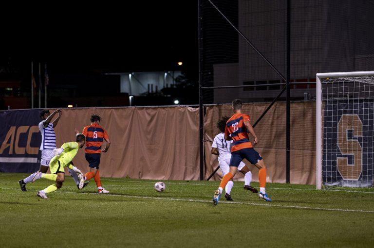 Freshman midfielder Curt Calov scores a goal during a Syracuse men's soccer match against Niagara at the SU Soccer Stadium, September 6.