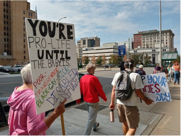 Pro-choice advocates march through Syracuse on Saturday, October 2.