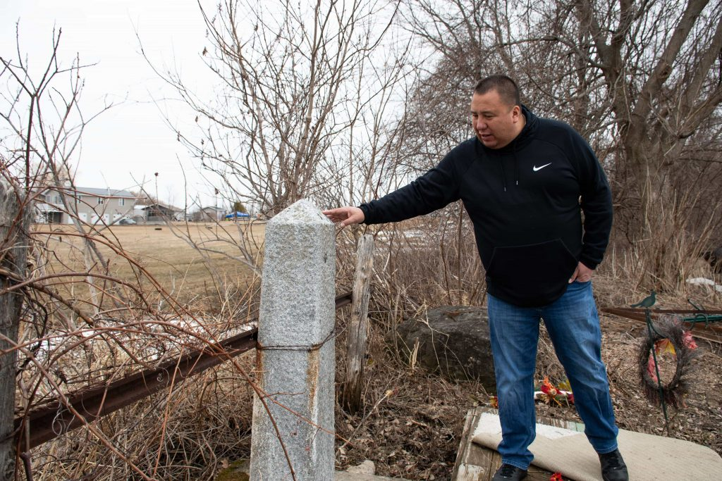 The United States-Canadian border runs through the backyard of Matthew Rourke's parents' home on the Saint Lawrence River. The only sign of the division is a singular, concrete pillar.