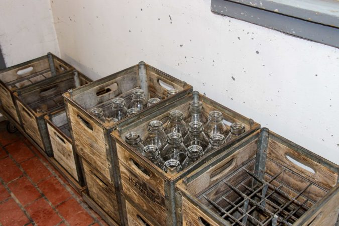 At Hoover's Dairy, customers drop their used glass bottles in the crate before buying fresh bottles of milk.