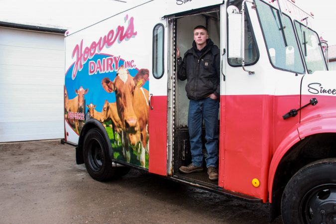 Robbie Hoover, 19, delivers glass bottles of milk twice daily, three days a week, from his family's farm in Sanborn, N.Y.; he plans to fill his father's shoes at Hoover's Dairy farm and continue to diversify operations.