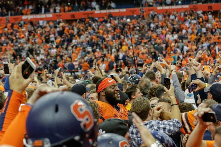 Syracuse fans storm the Carrier Dome field after SU upset Clemson 27-24 in 2017.