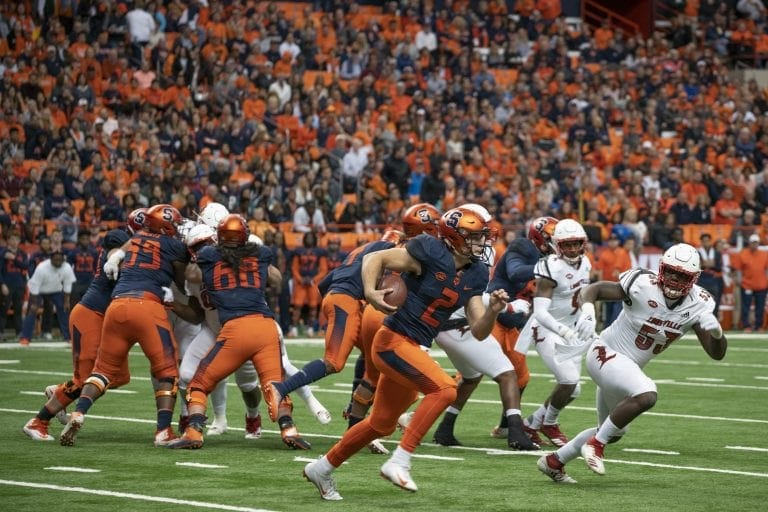 Eric Dungey runs against Louisville's defense in the Orange's win on Nov. 9, 2018.
