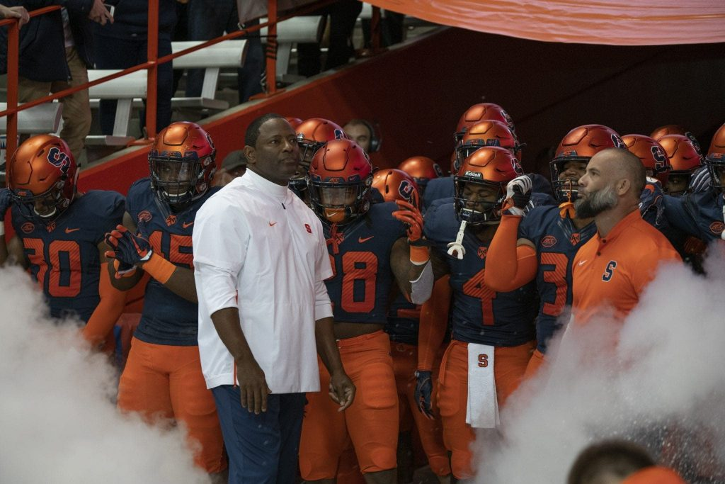 Dino Babers stands with his Syracuse football team prior to the Louisville game in the Carrier Dome on Nov. 10, 2018.