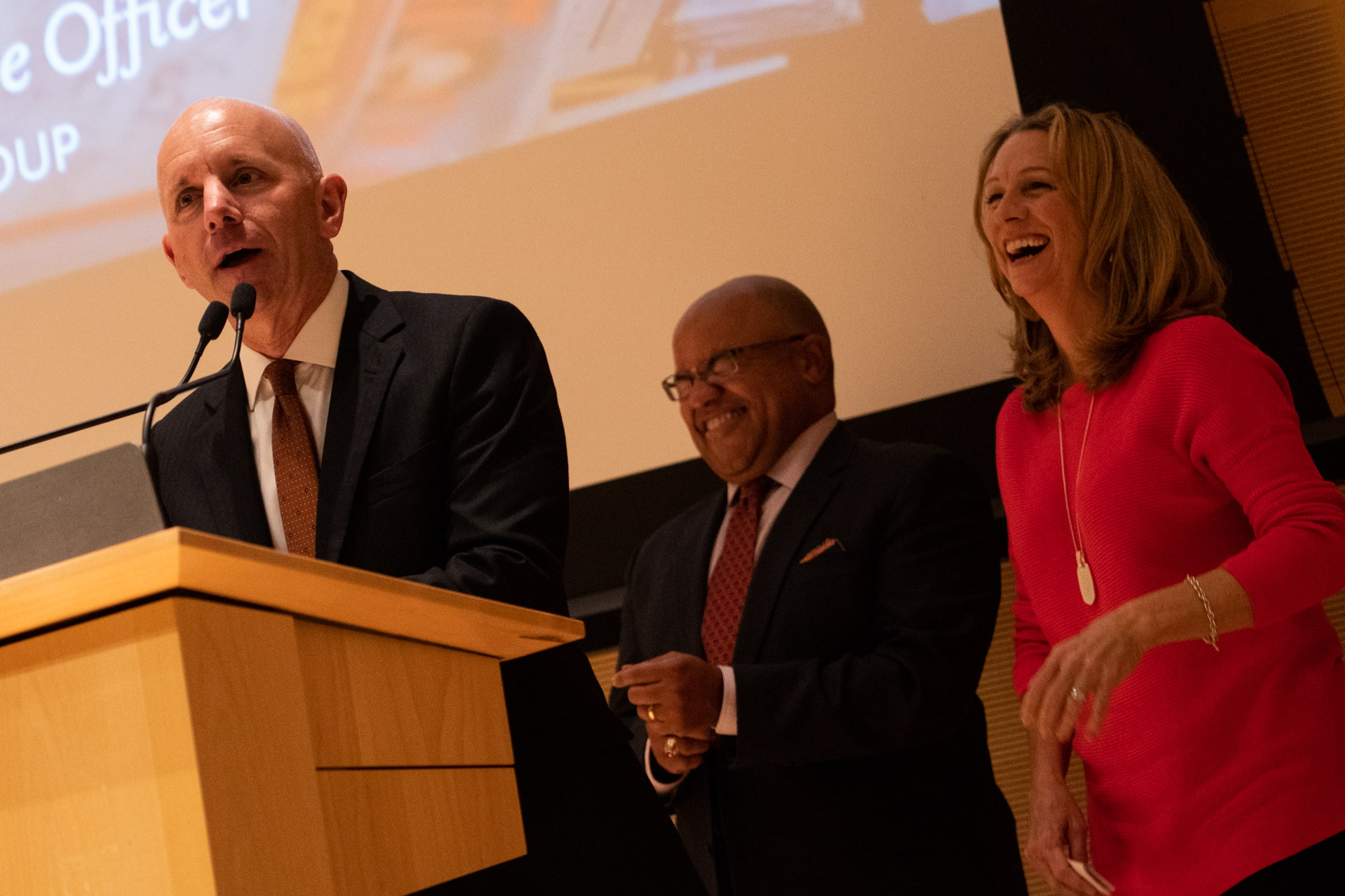 ESPN broadcaster Sean McDonough shares remarks about Glickman Award winner Sandy Montag much to the amusement of fellow broadcasters Mike Tirico and Beth Mowins.