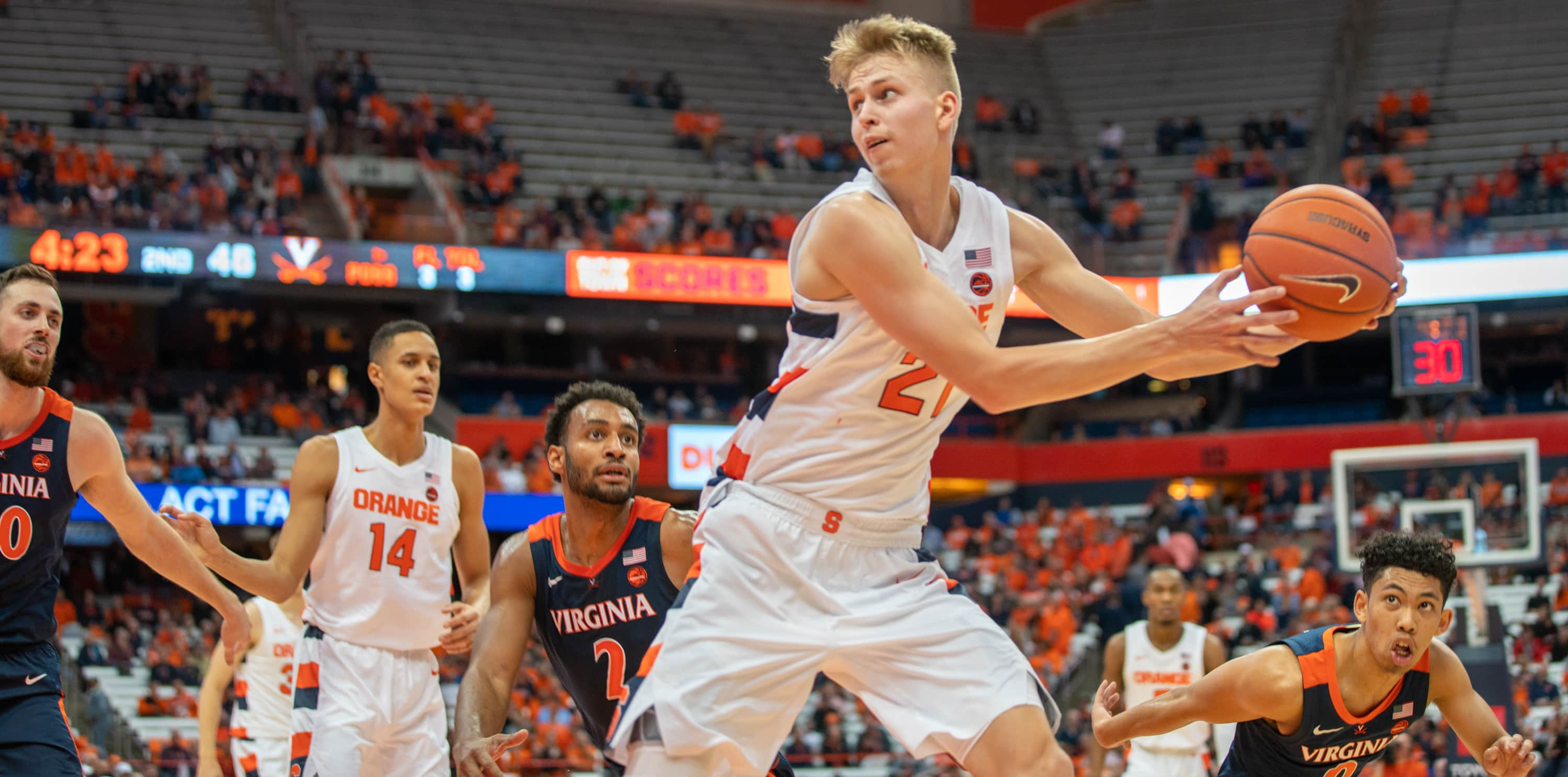 Marek Dolezaj under pressure during SU's loss to Virginia on Nov. 6, 2019.
