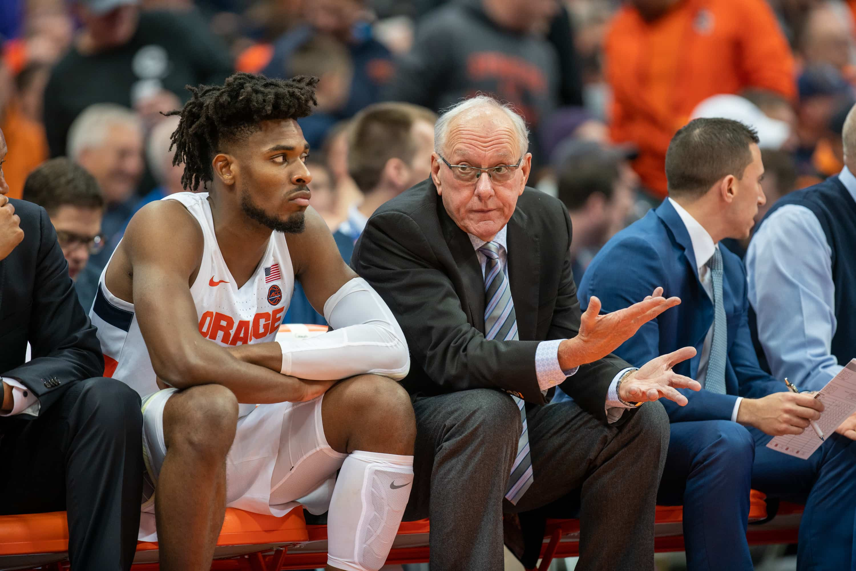 Coach Jim Boeheim talks to Quincy Guerrier on the bench during SU's loss to Virginia on Nov. 6, 2019.