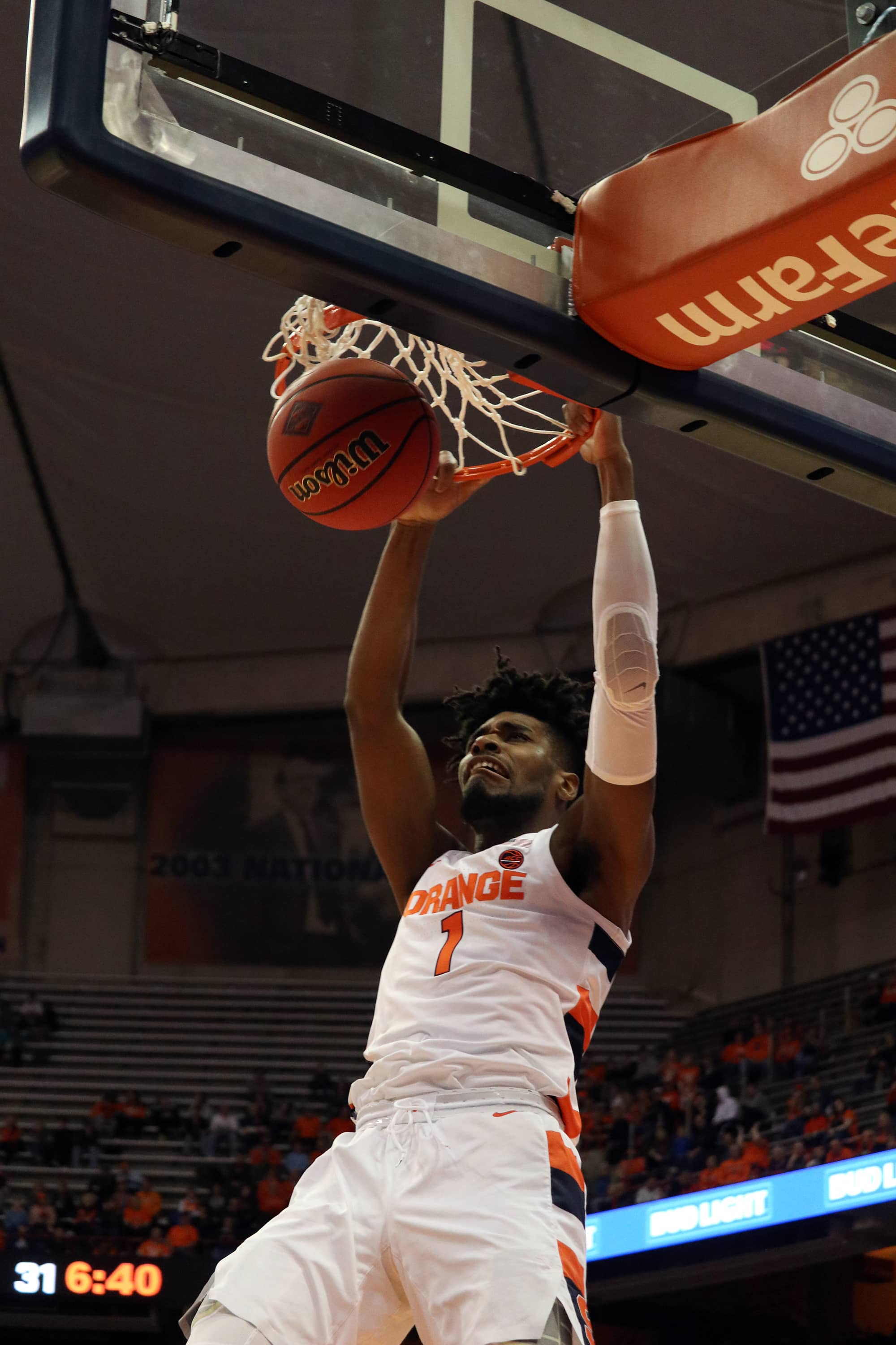 Syracuse University's forward Quincy Guerrier (1), dunks the basketball against Seattle University during the first half of a college basketball game on Nov. 16, 2019. Syracuse beat Seattle with a score of 89 to 67.