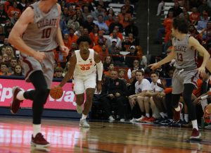 Elijah Hughes brings up the ball against Colgate on Nov. 13, 2019, in the Carrier Dome.