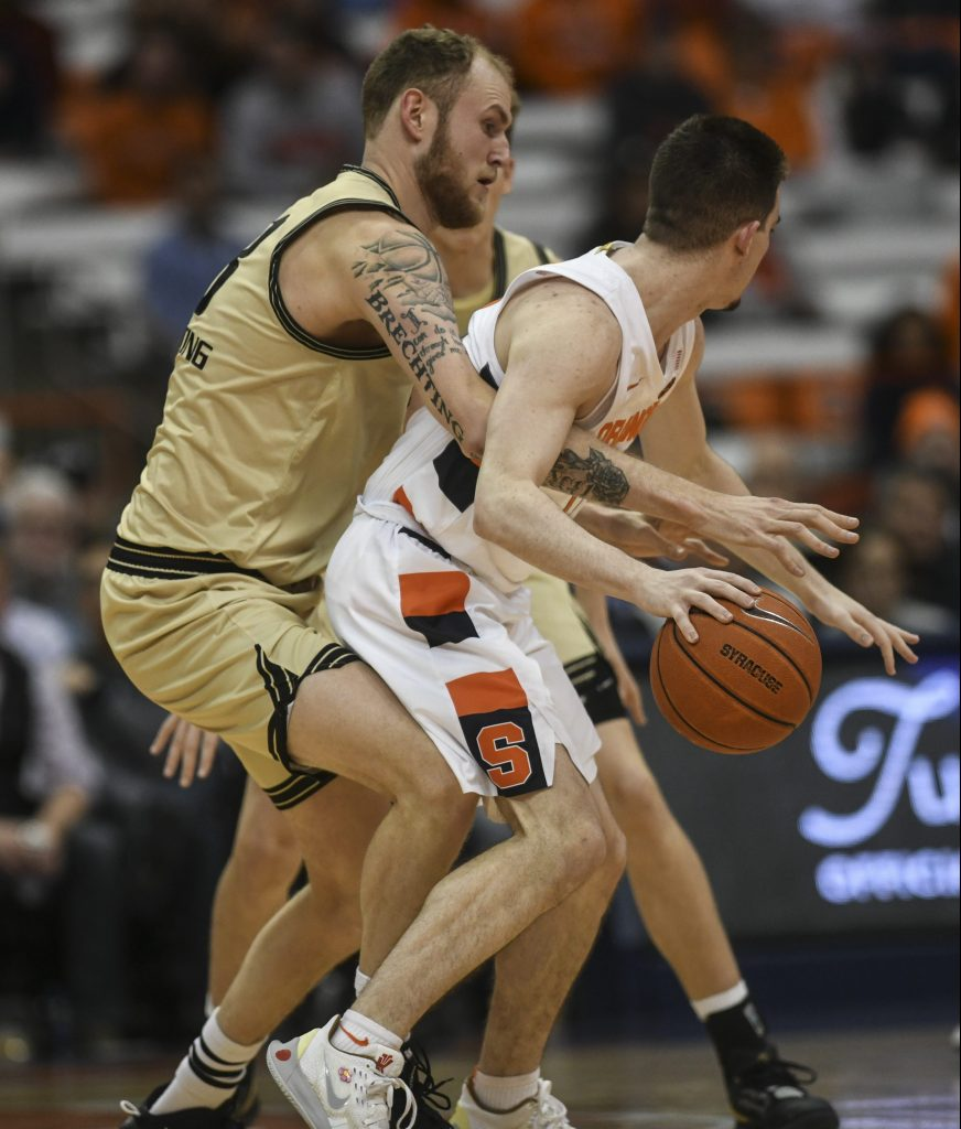 Syracuse Basketball vs. Oakland - Oakland's Brad Brechting gets his arm wrapped up in Syracuse's Joe Girard III's