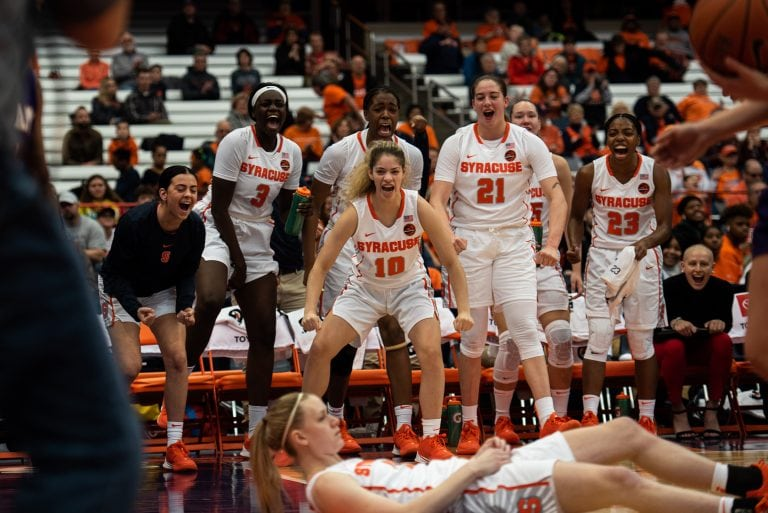 Syracuse cheers after Brooke Alexander scores a layup and draws a foul. Alexander hit her free-throw, making it a three-point play.