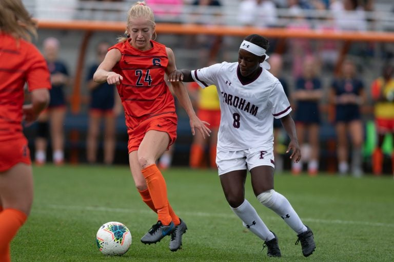 Meghan Root (24) and Danielle Etienne (8) fight for the ball during the game at the SU Soccer Stadium on Sept.15, 2019.
