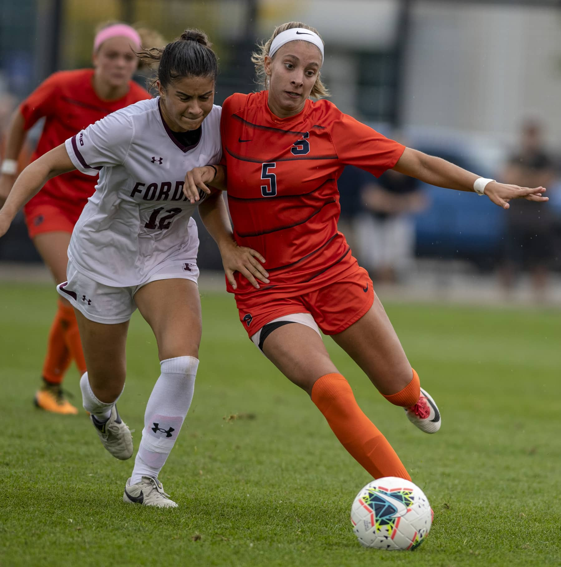 Saige Bingman (12) and Marisa Fischetti (5) fight for the ball during the game at the SU soccer stadium on Sept.15. Photo by Zoe Davis for the Newshouse.