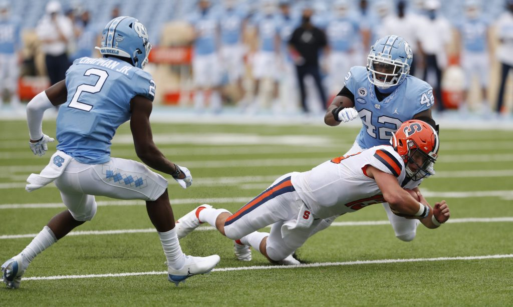Syracuse quarterback Tommy DeVito (13) dives for extra yardage in first half action as the Orange face the UNC Tar Heels in ACC football action in Chapel Hill, N.C. Saturday, Sept. 13, 2020.
