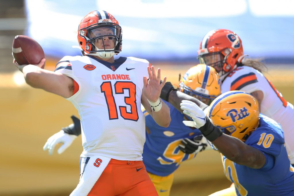 Sep 19, 2020; Pittsburgh, Pennsylvania, USA; Syracuse Orange quarterback Tommy DeVito (13) passes the ball against the Pittsburgh Panthers during the third quarter at Heinz Field.